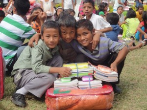 Children at Gilgal Children's Home receiving school supplies