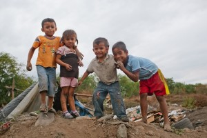 Local children playing in the dump, but standing with hope