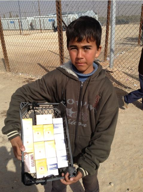 Child selling cigarettes