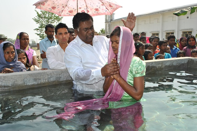 Subela taking baptism