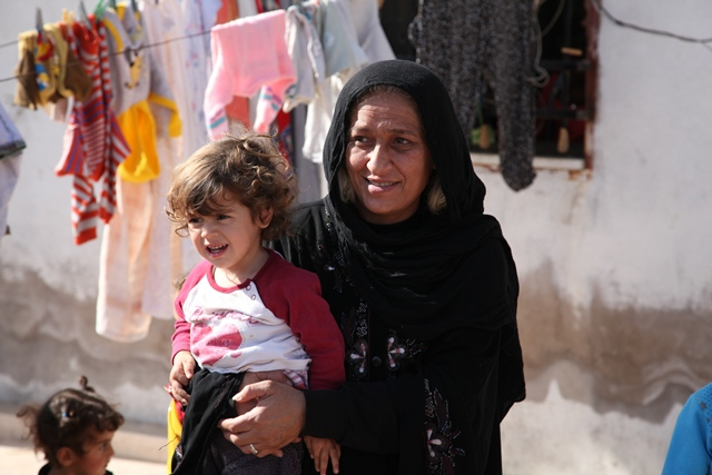 Syrian Women and her child in Jordan Refugee Camp