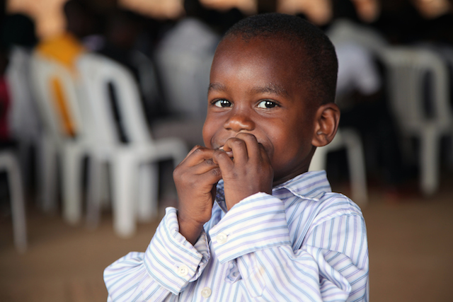 Ugandan boy at church in Kampala slum World Help 2013