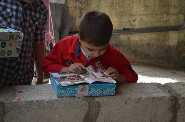 Syrian child with Bible - World Help