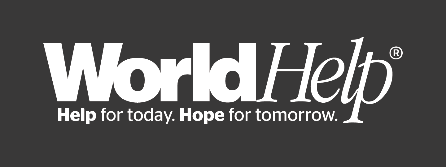 World-Help-logo-with-tagline-white
