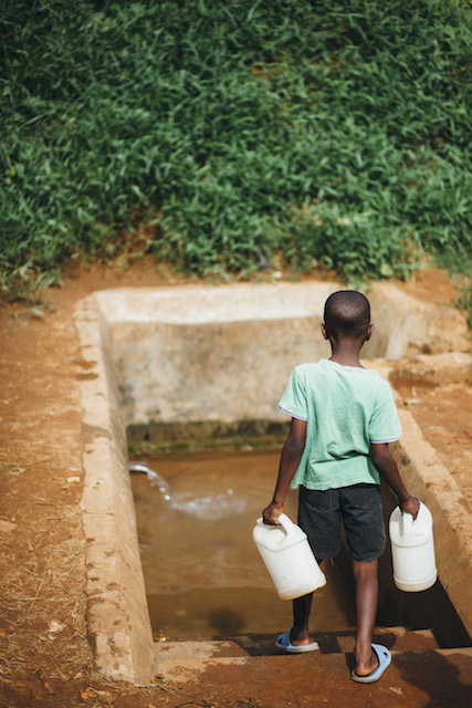 Child collecting water - World Help