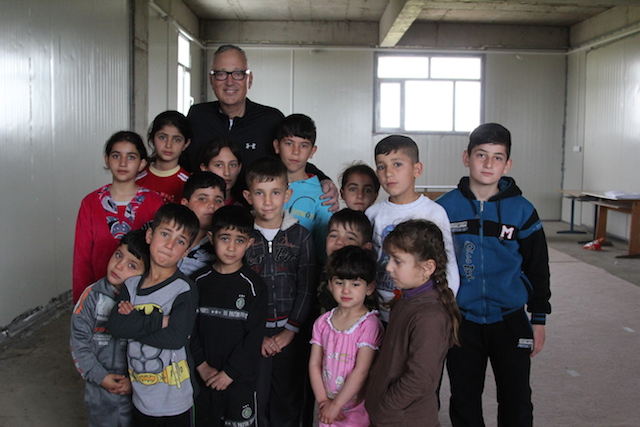 Vernon Brewer with Iraqi Children