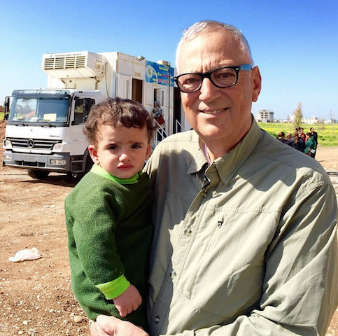 Vernon Brewer with Iraqi Refugee Child