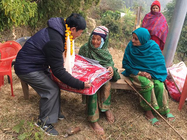 World Help Nepal Distributing Blankets