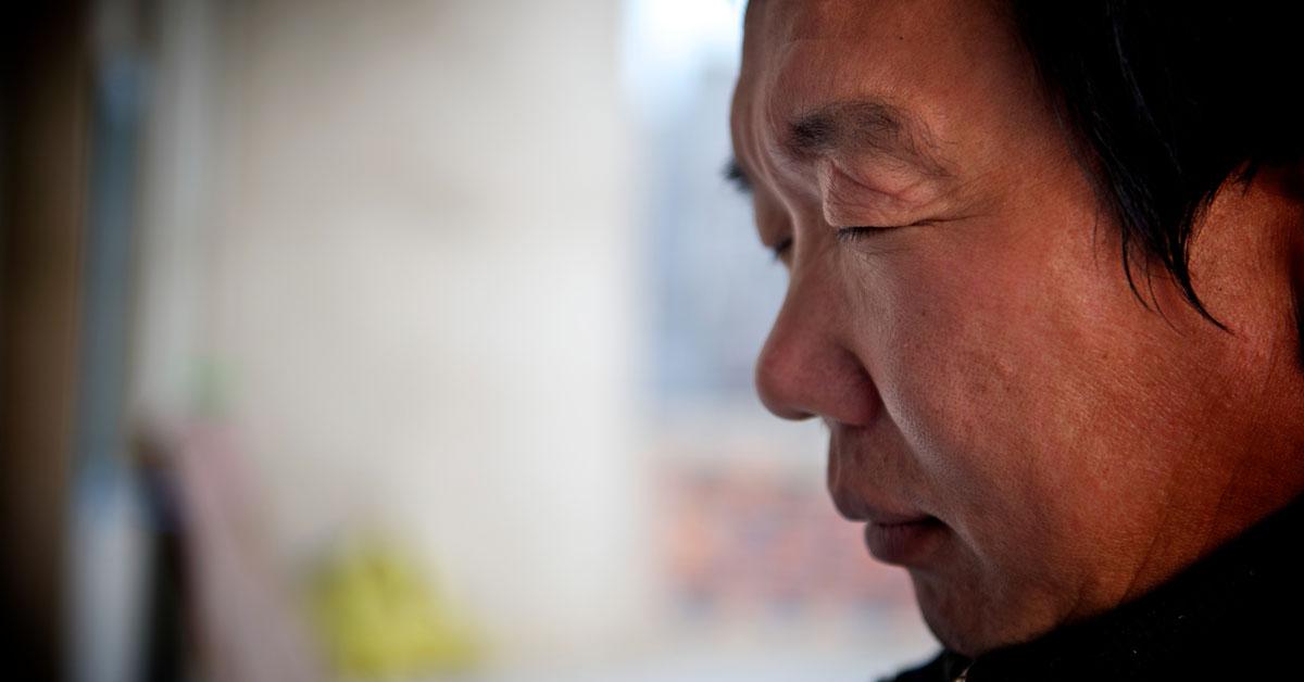 North Korean man praying