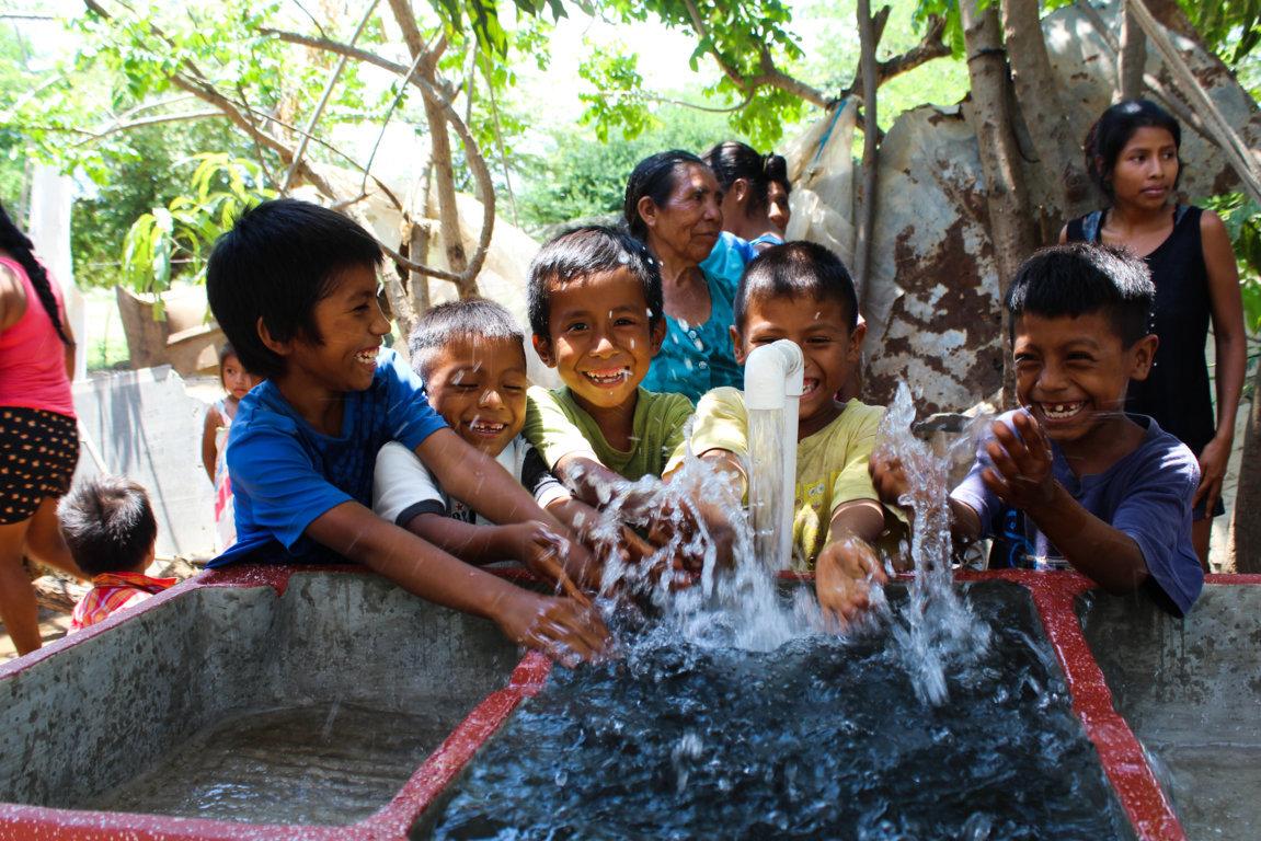 Kids splash in a water basin