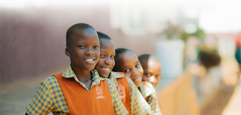 Kids Smiling in orange vests | World Help